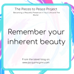 "Text reads ""remember your inherent beauty"" with creative pink, turquoise and purple paint splodges as a background."